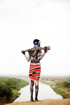 Ak-47 Photograph - A Young Man Holds His Kalashnikov Rifle by Michael Hanson