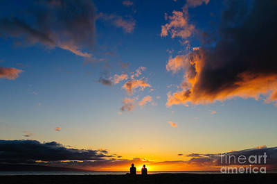 Photograph - Couple Watching The Sunset On A Beach In Maui Hawaii Usa by Don Landwehrle