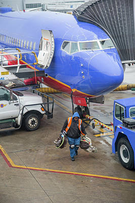 Southwest Gate Photograph - Ground Crew Worker At Chicago Airport by Jim West