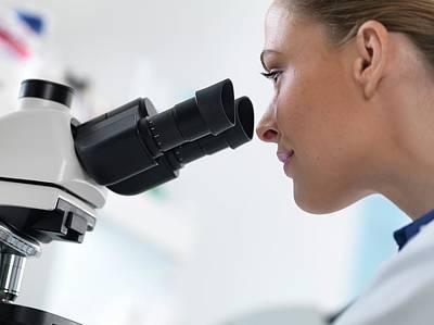 Human Head Photograph - Scientist Using Microscope by Tek Image