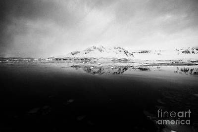 Reflective Surfaces Photograph - snow covered landscape in Fournier Bay on Anvers Island Antarctica by Joe Fox