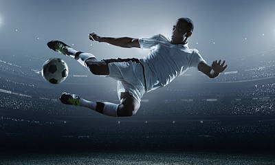 Flying Photograph - Soccer Player Kicking Ball In Stadium by Dmytro Aksonov
