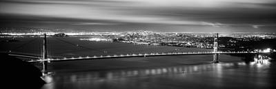 Bay Bridge Photograph - Suspension Bridge Lit Up At Dusk by Panoramic Images