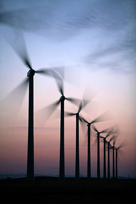 Tall Windmills Are Silhouetted Art Print