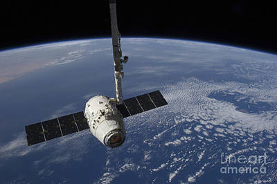 Fantasy Royalty-Free and Rights-Managed Images - The Spacex Dragon Cargo Craft  Prior by Stocktrek Images