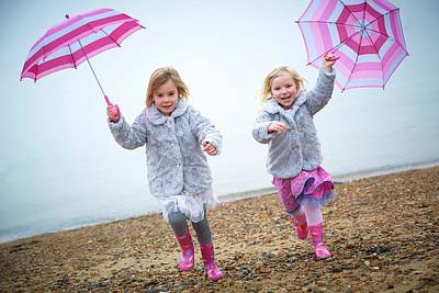 Candid Photograph - Two Girls On Beach Holding Umbrellas by Ruth Jenkinson