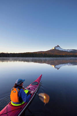 Kayak Photograph - Usa, Oregon A Woman In A Sea Kayak by Gary Luhm