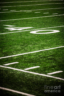 Football Royalty-Free and Rights-Managed Images - 40 Yard Line on a Football Field by Paul Velgos