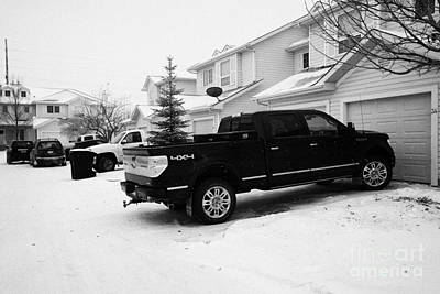 Sask Photograph - 4x4 Pickup Trucks Parked In Driveway In Snow Covered Residential Street During Winter Saskatoon Sask by Joe Fox