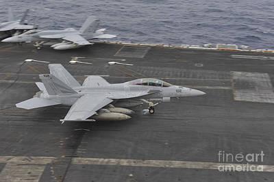 Fine Dining - An Fa-18f Super Hornet Lands by Stocktrek Images