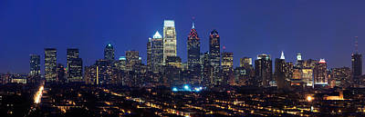 Philadelphia Skyline Photograph - Buildings Lit Up At Night In A City by Panoramic Images