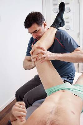 Manipulation Photograph - Hip Injury Physiotherapy by Thomas Fredberg