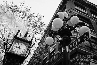 Streetlight Photograph - old steam powered clock on water street in the historic gastown district Vancouver BC Canada by Joe Fox