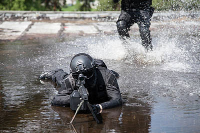Photograph - Spec Ops Police Officers Swat In Action by Oleg Zabielin
