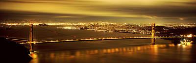 Bay Bridge Photograph - Suspension Bridge Lit Up At Dusk by Panoramic Images