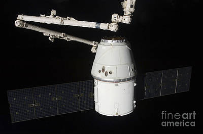 Fantasy Royalty-Free and Rights-Managed Images - The Spacex Dragon Cargo Craft by Stocktrek Images