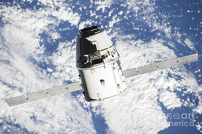 Fantasy Royalty-Free and Rights-Managed Images - The Spacex Dragon Commercial Cargo by Stocktrek Images