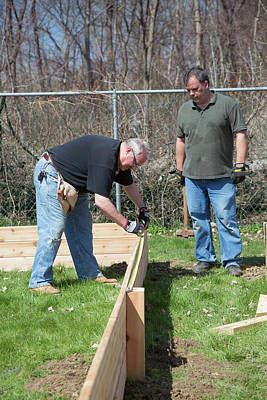 Hammer Photograph - Volunteers Building Raised Beds by Jim West