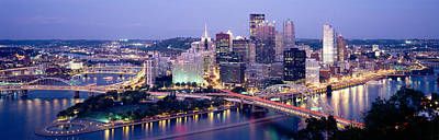 Pittsburgh Photograph - Buildings In A City Lit Up At Dusk by Panoramic Images