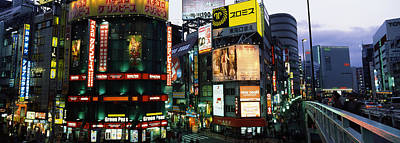 Shinjuku Photograph - Buildings In A City Lit Up At Night by Panoramic Images