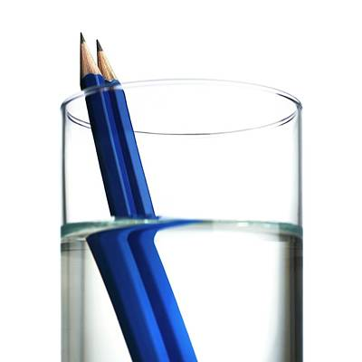 Illusory Photograph - Refraction In A Glass Of Water by Science Photo Library