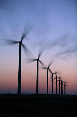 Prairie Sunset Wall Art - Photograph - Tall Windmills Are Silhouetted by Todd Korol