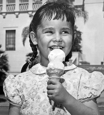 Cream Photograph - Girl With Ice Cream Cone by Underwood Archives