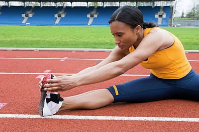 Athlete Stretching Art Print by Gustoimages/science Photo Library