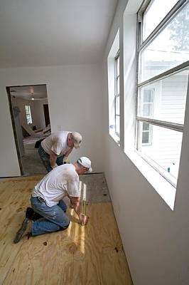 Helping Photograph - Repairing Hurricane Katrina Damage by Jim West