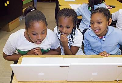 Schoolgirl Photograph - Primary School Computer Lesson by Jim West