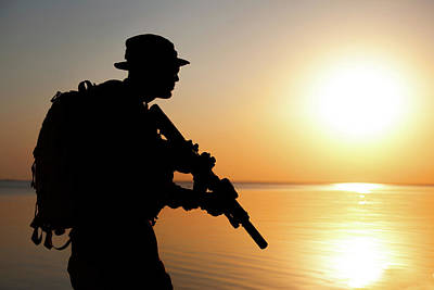Photograph - Silhouette Of Army Soldier With Rifle by Oleg Zabielin
