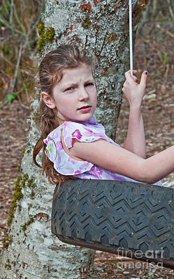 Photograph - 9 Year Old Caucasian Girl In Tire Swing by Valerie Garner