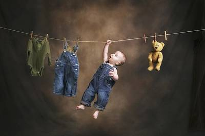 A Baby On The Clothesline Print by Pete Stec