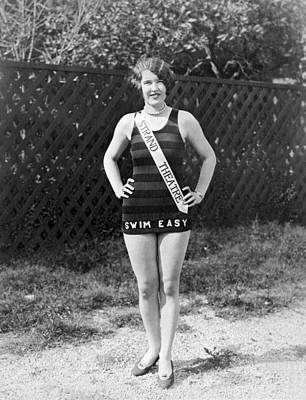 One Piece Swimsuit Photograph - A Bathing Suit With Advertising by Underwood Archives