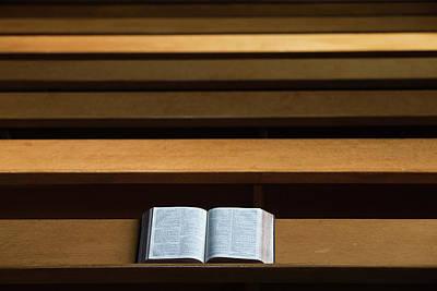 A Bible Open On A Wooden Bench Art Print
