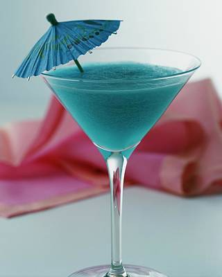 Alcohol Photograph - A Blue Hawaiian Cocktail by Romulo Yanes
