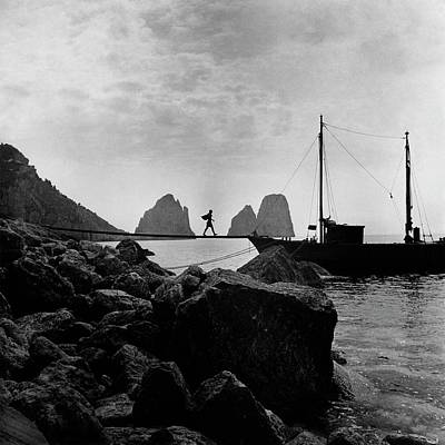 Edge Photograph - A Boat Docked At Capri by Clifford Coffin