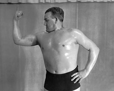 Bare-chested Photograph - A Body Builder Poses by Underwood Archives