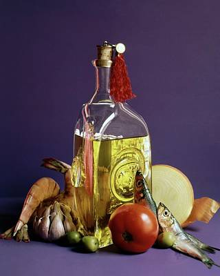A Bottle Of Olive Oil Surrounded By A Variety Art Print by Fotiades