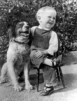 Best Friend Photograph - A Boy Laughs With His Dog by Underwood Archives