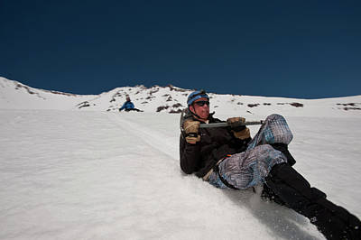 Mt Shasta Photograph - A Boy Slides Down A Snow Slope by Beth Wald