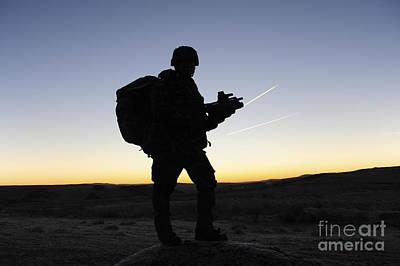 A British Soldier On Patrol As The Sun Art Print