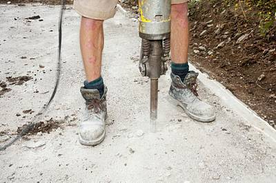 Hammer Photograph - A Builder Using A Jack Hammer by Ashley Cooper