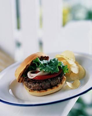 Hamburger Photograph - A Burger With Potato Chips by Romulo Yanes