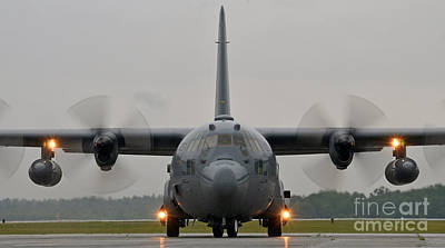 Us Army Fighters Photograph - A C-130 Hercules Taxis On The Flight Line by Celestial Images