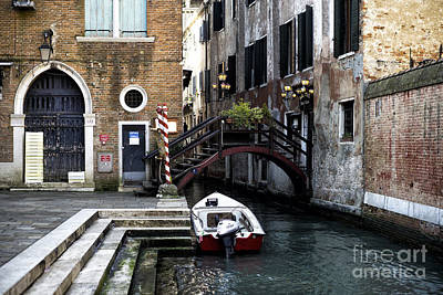Photograph - A Canal In Venice by John Rizzuto
