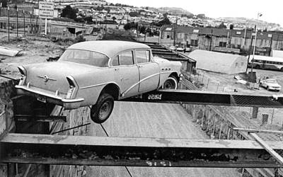 Photograph - A Car Precariously Balanced by Underwood Archives