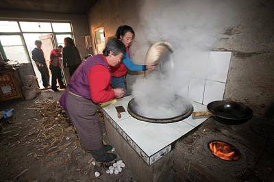 Stove Photograph - A Chinese Family Cooks On A Stove by Ashley Cooper