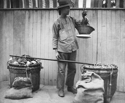 Street Vendors Photograph - A Chinese Fruit Vendor by Underwood Archives