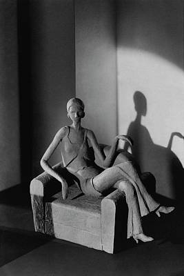 Photograph - A Clay Figure Sitting On A Chair by  Barnaba